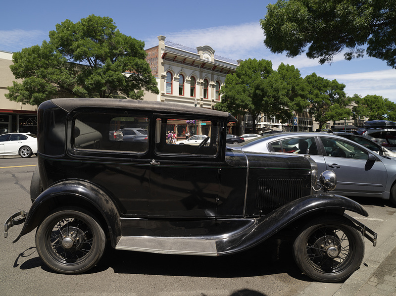 A c. 1932 Model A Ford found a parking spot next to autos that are nearly a century older in downtown Walla Walla, Washington, once the largest city in a vast region when Washington was a U.S. territory and now an agriculutral (especially wheat) and winemaking hub of Eastern Washington<br />
